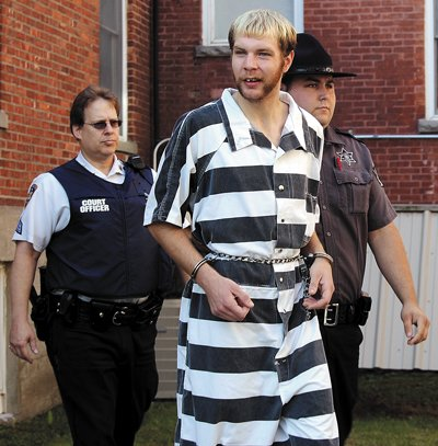 Dustin C. Hill, Plattsburgh, is led into Plattsburgh City Court Wednesday morning where he appeared before the Hon. Penelope D. Clute. Hill's preliminary hearing was held that afternoon.
