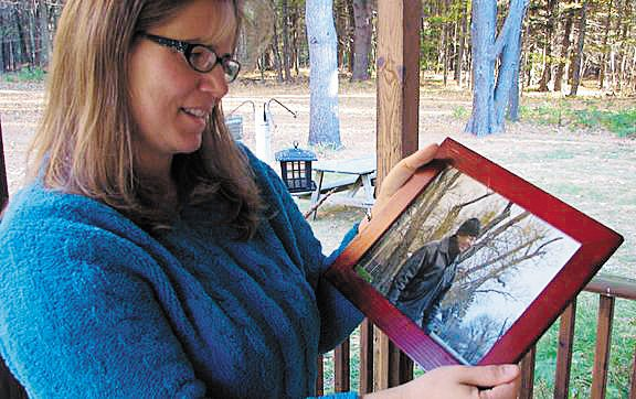 Debbie Frederick holds a photo of her father, the late Doug Hoffman of Mooers Forks, who passed away in August 2009 following complications from Alzheimer's disease. A 5k fun run and walk will be held in Hoffman's memory Saturday, Aug. 20, at the Wellness Center at PARC in Plattsburgh.