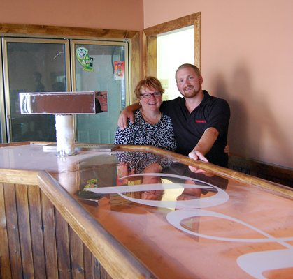 Scott Bazzano and his mother, Sandy, stand behind the counter of the new Pasquale's location soon to open in the village of Dannemora on Cook Street.