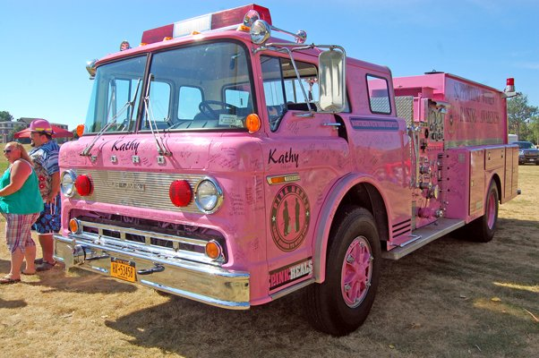 The pink fire truck owned by the Northern New York chapter of Guardians of the Ribbon is currently out of commission as it awaits repair work. A spaghetti dinner is planned this Sunday, Aug. 21, to raise money for the truck, seen here at a recent benefit in Plattsburgh.
