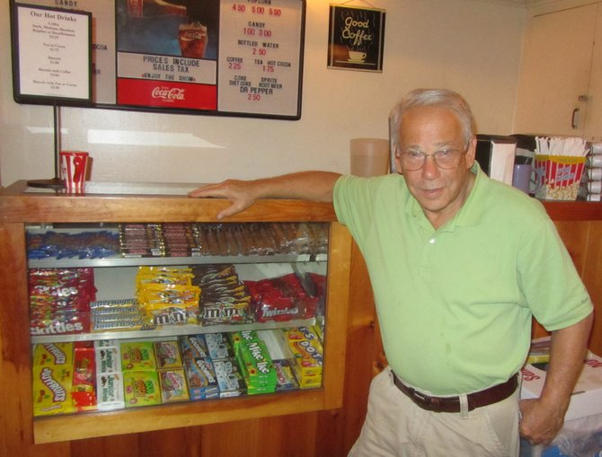Nat Tobin stands inside the Manlius Art Cinema, which he has owned and operated for 19 years.