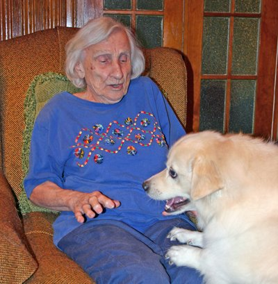During an interview this week, Sister Catherine Schuyler, who's turning 100 years old on Aug. 23, urges her pet dog Korby to jump into her lap.