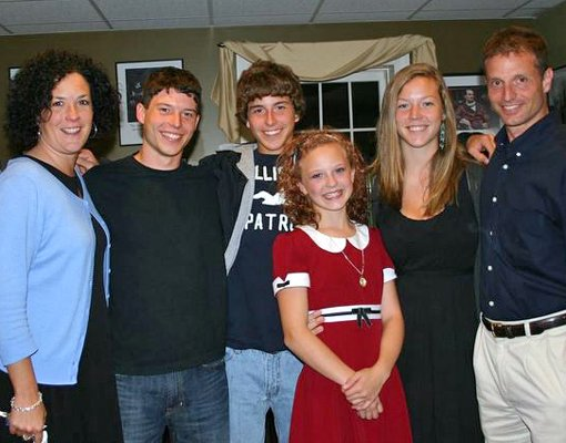 "Thirteen-year-old Julie Ruff poses with her family after closing night of a production of ""Annie"" at the Berkshire Theatre Festival in Stockbridge, Mass., where she had the title role. Julie was joined, from left, by her mother, LeeAnne; brothers Jordan and Justus; sister, Jenna; and father, Jon."