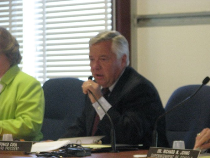Liverpool Central School District Board of Education President Don Cook speaks before a public hearing on a proposed grade reconfiguration in the district on Tuesday Aug. 23.