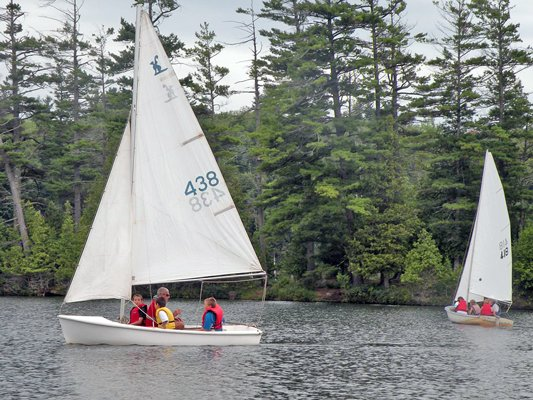 Participants in Minerva's sailing youth program spend some time on the water.