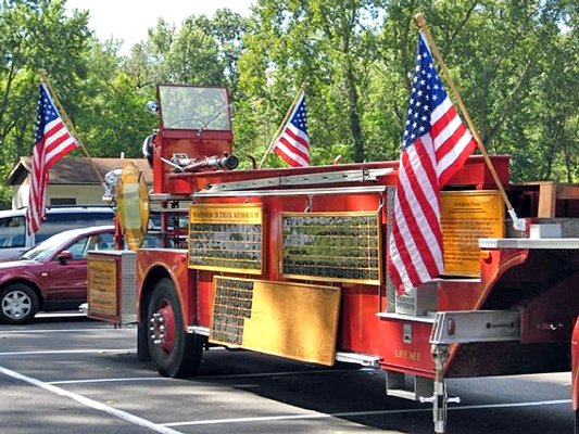 Sponsored by the Port Henry Fire Department Auxiliary, MacBoston 18 Truck will return as part of Port Henrys annual Labor Day celebration. The fire truck is an inspirational and memorial vehicle in tribute to  fallen firefighters.The truck includes the names of firefighters who died in the line of duty engraved on its side. A local firefighters name will be added to the truck during this years Labor Day celebration. Beverly Pratt, the father of Port Henry Past Chief and Past President  William (Billy) Pratts father, will be honored.