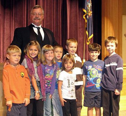 Impersonator Joe Wiegand visits with elementary students at Newcomb Central School as President Theodore Roosevelt. Wiegand will be in Newcomb again Sept. 9 as part of the town-wide Teddy Roosevelt Weekend festivities. He entertains audiences nationwide with his program.
