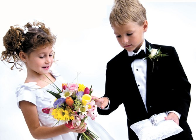 The flower girl and ring bearer accessories can help make the moment special.
