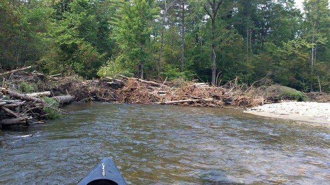 Paddling the Boquet River, from New Russia to The Wadhams Road in E-town, this was just one of the new log dams created by Tropical Storm Irene.