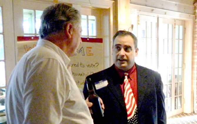 Candidate for Onondaga County legislature district 6 seat Mike Plochocki, right, talks with Skaneateles Town Councilman Rick Keyes, left, at the GOP meet and greet.