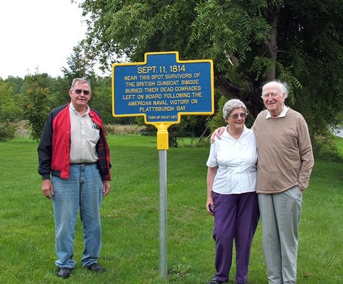 Robert Cheeseman, historian for the town of Chazy, left, stands with Jo and Roy Carter in front of the marker they worked to get established on Lake Shore Road. The marker recognizes the lives of British soldiers lost during the American Naval victory on Plattsburgh Bay.