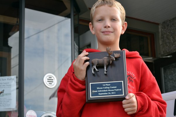 TOP MOOSER - Delaware kid Mickey McKinney is the first-ever champ of Indian Lakes Moose Calling Contest. Awarded following the competition in the Indian Lake Theater Sept. 24, judge and author Ed Kanze noted that McKinney reached the highest volume of the contestants.