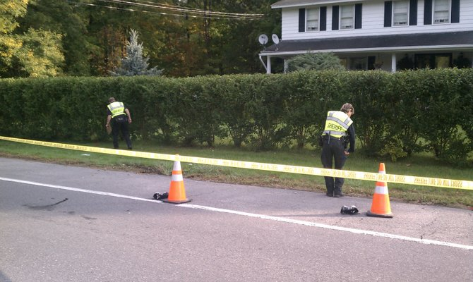 Onondaga County Sheriff's deputies search for evidence at the scene of a hit and run accident that claimed the life of 19-year-old Joseph Ozimek, a senior at Liverpool High School. Aaron Sakaran, also 19, has been arrested in connection with the accident and will be arraigned Thursday night.