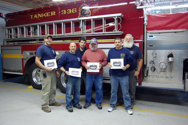 Members of the West Chazy Volunteer Fire Department will be heading out next Sunday, Oct. 30, with copies of their newest calendar. Each year, the department gives free calendars to the community thanks to the support of local businesses. Shown, from left, are firefighters Todd Nephew, Jason Goodspeed, Kevin Girard, Bob Mooso, Robby Carron and Art Hart.