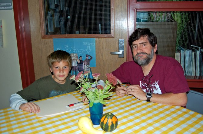 DavidCraig of Keene sits with his new mentee, Joseph Wilson of grade 5. 	