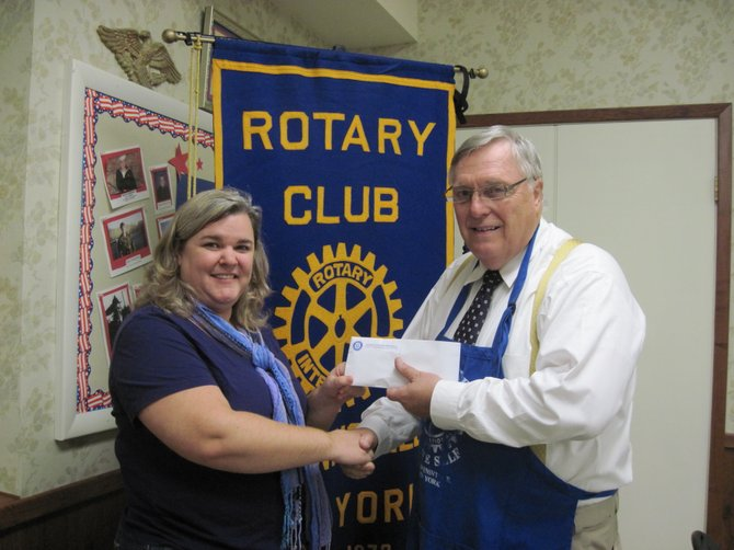 Rotary Club of Baldwinsville President Marv Joslyn presents the evening's raffle proceeds, an $83 donation, to Megan O'Donnell, Treasurer for the Volunteer Center Board. The money was raised at the Rotary Club's monthly spaghetti dinner.