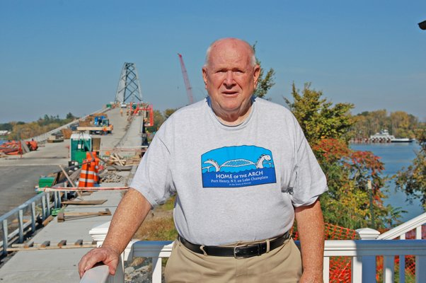 Volunteer Archie Rosenquist stands outside the Lake Champlain Information Center, located in the old tollhouse of the Lake Champlain Bridge, on Sunday, Oct. 9, 2011, the day the bridge was originally slated to open. Due to flooding in the spring, construction was delayed, and the contractor — Flatiron Construction — was given a 65-day extension to finish the bridge. The new deadline: Dec. 13, 2011.