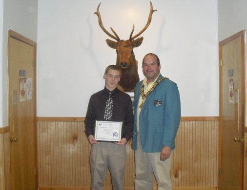 Michael Halka, esteemed leading knight, awards Brian Bulingame, left, with the student of the month honor. Burlingame, a senior at Baker High School, was chosen for the honor by the Liverpool Elks Club.