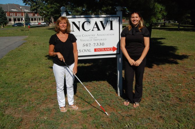 Anne Wittmann, at right, has joined the North Country Association for the Visually Impaired as an orientation and mobility specialist. Wittmann is joined, at left, by NCAVI executive director Donna M. Abair, who holds a white cane, one of the assistive tools for the visually-impaired available through the organization.