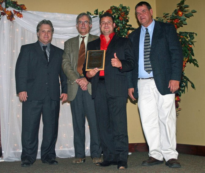 Award receipients, from left, Mike Perrotte, Lew Boyd, and Martin Roy with Airborne Speedway's Sherm Hamel.