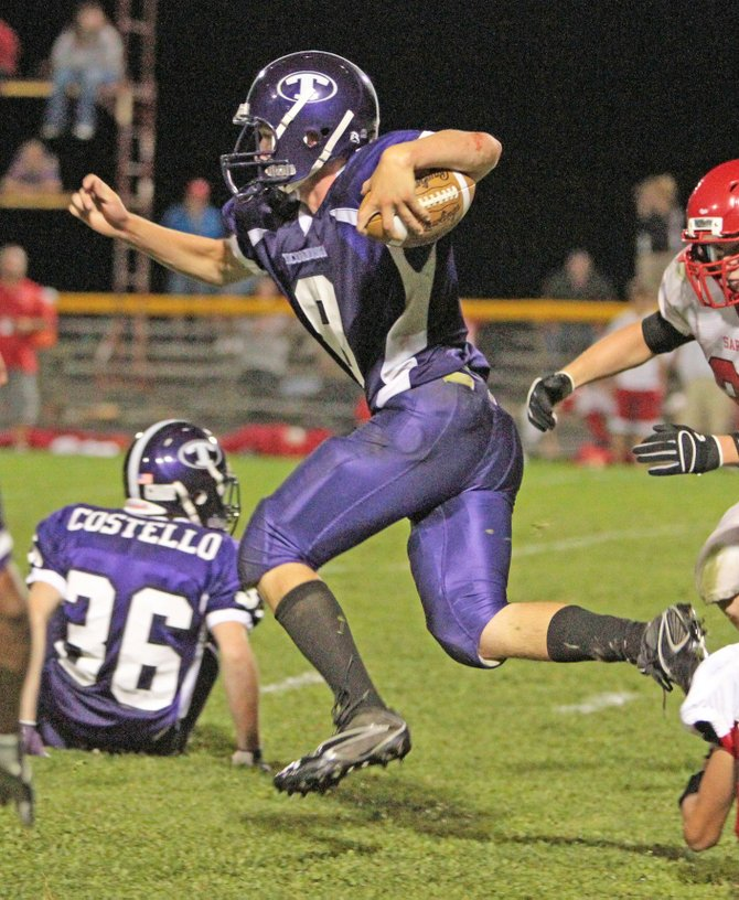 Nate Lenhart had a combined 205 yards of offense in the Class D regional Championship game against Cambridge Nov. 11.