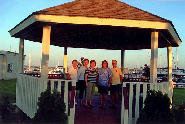 Volunteers who cleaned up the Peg and John Huchro Memorial Gazebo were, from left, Geri Favreau, Kay Papin, Mary Racicot, Sue Chenevert and Nancy Baker. Not pictured: Judy Mousseau.