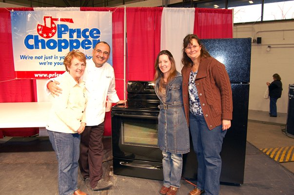 Taste of Home Cooking School culinary specialist Eric Villegas poses with Nancy Finley of West Chazy, left, and her family. Finley was the winner of a Frigidaire range donated by Wilson's Appliance Centers in Plattsburgh. The range was the grand prize given out at the event.