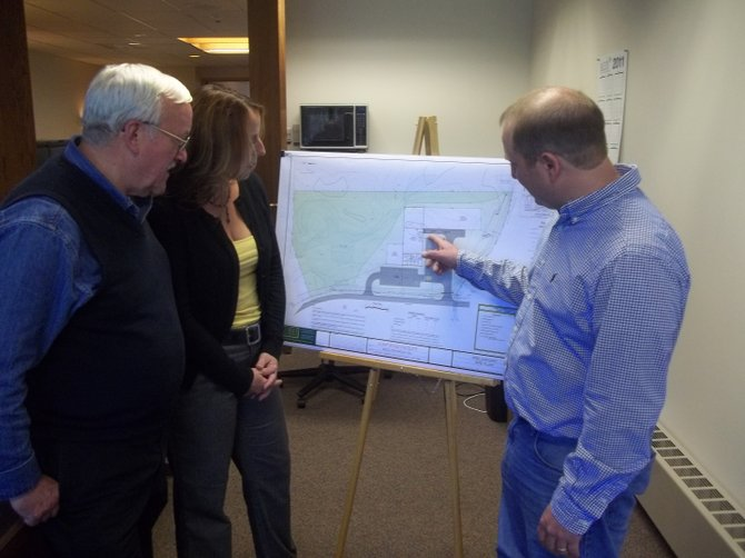 BACO President Tom Rogers, right, reviews his site plan with Supervisor Barry Bullis, left, and Lynn Tanner.
