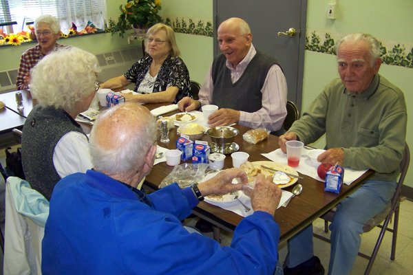 Seniors at the Chestertown mealsite enjoy a luncheon meal recently. The kitchens at various mealsites are to be closed down, which some county officials said this week would likely reduce participation in the program.