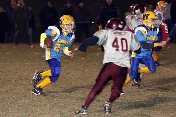 Burgher ground-gainer John Kelly eyes a potential route past a Whitehall defender as he heads downfield during Warrensburg's victory in the Northern Adirondack Youth Football League's first-ever Superbowl showdown.