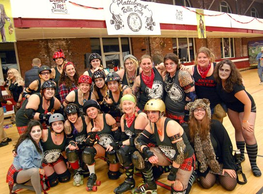 Members of the North Country Lumber Jills celebrate following their win against the Twin City Riot Oct. 29.