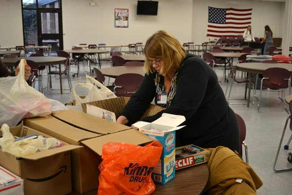 "Barb Bushey, a job coach with the Northeastern Clinton Central School District, helps pack boxes for her son's U.S. Army unit, serving overseas. Donations from a now ongoing supply drive at the school are being sent on a monthly basis. For more information, search ""Supplies for Soldiers"" on Facebook."