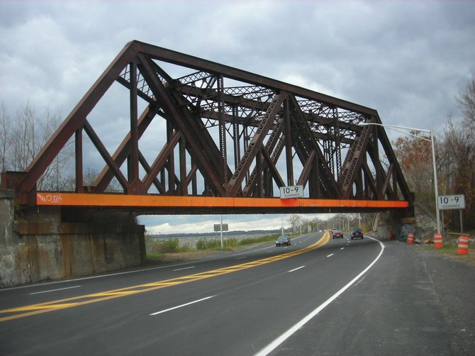 NYSDOT will soon institute a ban on all commercial traffic on Onondaga Lake Parkway to prevent over-height vehicles from hitting this low railroad bridge, the site of numerous accidents, including a fatal Megabus accident last September.
