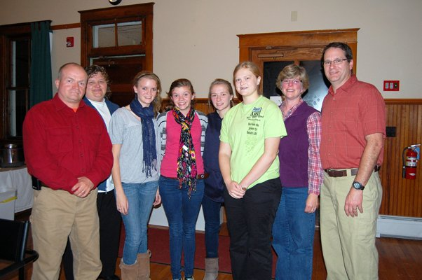 Ben, Nicky, Megan and Mallory Sudduth stand with Molly, Emily, Julie and Brad Rascoe after the Citizen of the Year Award ceremony at the Westport Heritage center.