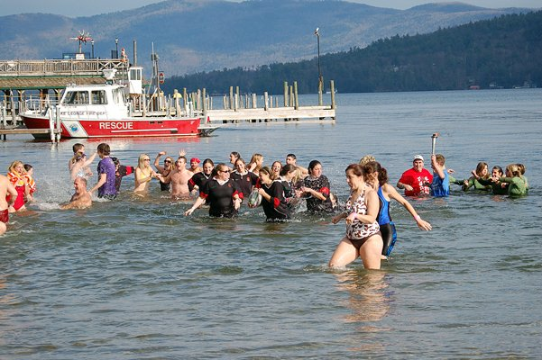 The first wave of swimmers of more than 300 frolic in the waters of Lake George during the 2010 Polar Plunge for Special Olympics. This year, more than $25,000 has been raised in advance of the event, set for Saturday, Nov. 19.