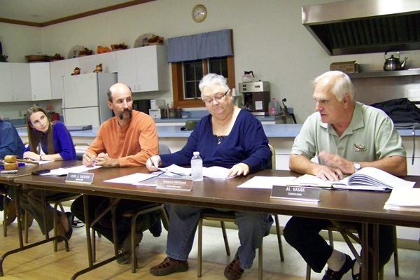 Town board members discussed municipal trash collection at their special budget meeting Monday, Nov. 14, and after more than a few exchanges of angry words, decided to eliminate it for 2012 and keep local property taxes flat, avoiding a predicted 15 to 18 percent increase.
