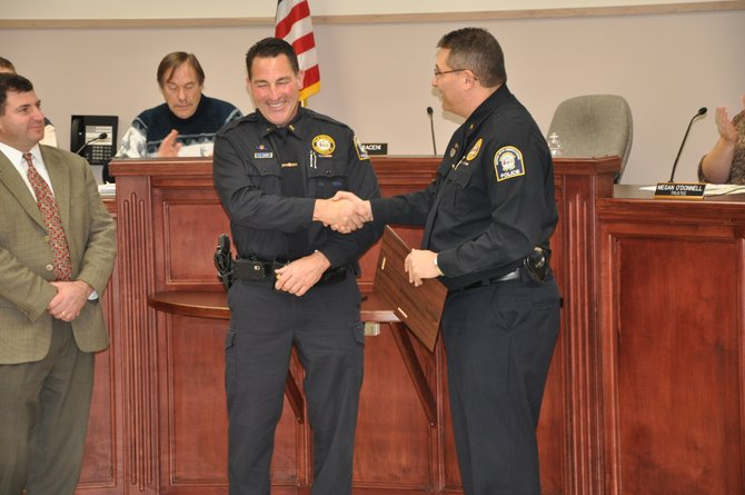Chief Michael W. Lefancheck, right, congratulates Lt. Thomas LeRoy, center, for receiving the Baldwinsville Police Department's Police Administrator's Special Recognition Award. With the two officers is Mayor Saraceni.