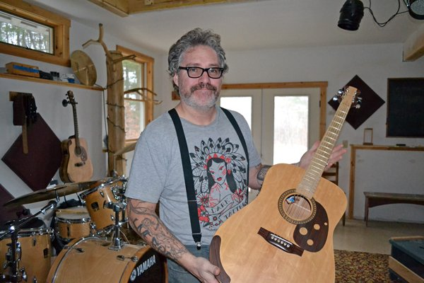Steven L. Smith, shown here at his Pottersville home, shot a video with his band in Bakers Mills recently, focused on his favorite performance venue, J&J's.