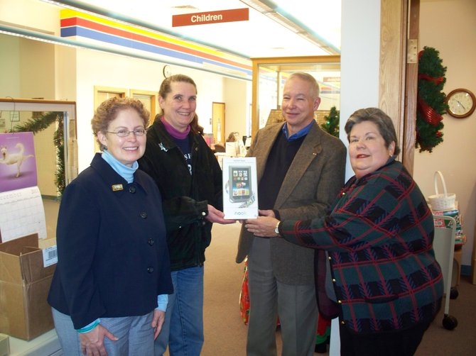 Char Hart, second from left, was the winner in the Baldwinsville Public Library's drawing for a Nook.