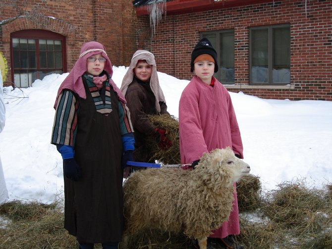 At last year's Live Nativity at First United Methodist Church in Baldwinsville, the shepherds who are tending their sheep at a previous Live Nativity at First United Methodist Church in Baldwinsville, are (from left) Michael Lawrence, Jared Kantak and Jonah Kantak. This year's Live Nativity, presented by members of First United Methodist Church in Baldwinsville, is Dec. 18. The event is free and includes refreshments, Christmas music and crafts for children.