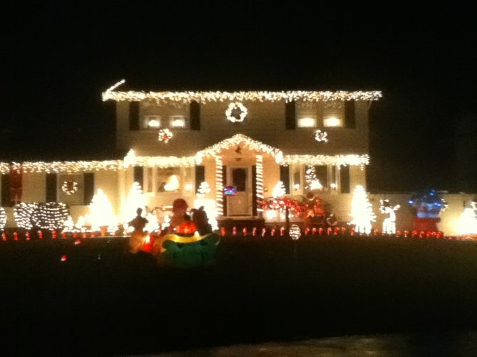 The home of John Bianco on Cedarpost Road at the corner of Harvest Lane in Clay lights up at Christmas time. This year, Bianco has taken up a collection for the food pantry at St. Joseph the Worker as part of his display,