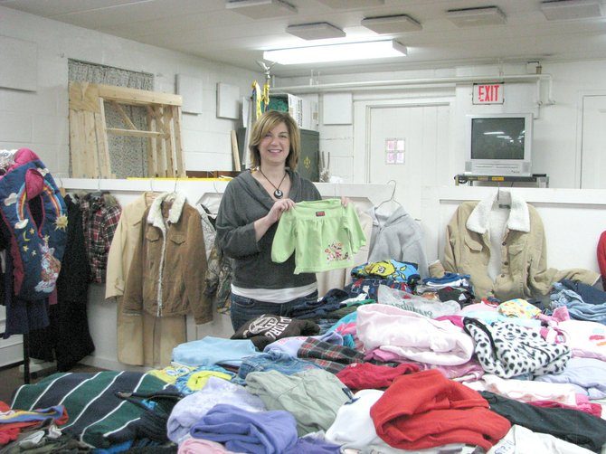 Alicia Wood shows off some of the wares available at Easter Morning, the clothing closet located in the basement of Calvary United Methodist Church in Mattydale.  The clothes are available for free to anyone in need in the community.