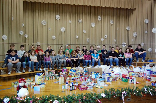 SPIRIT OF GIVING - Students in grades 3, 4, and 5 at Mooers Elementary School opted to donate money to the local food shelf instead of exchanging gifts this year.