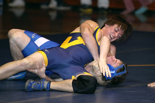 Warrensburg's Nick Nedelcu presses Hadley-Luzerne/Lake George's Jason Hoffman to the mat in a battle between two quite talented wrestlers during a meet between the Burghers and War Eagles Dec. 14.