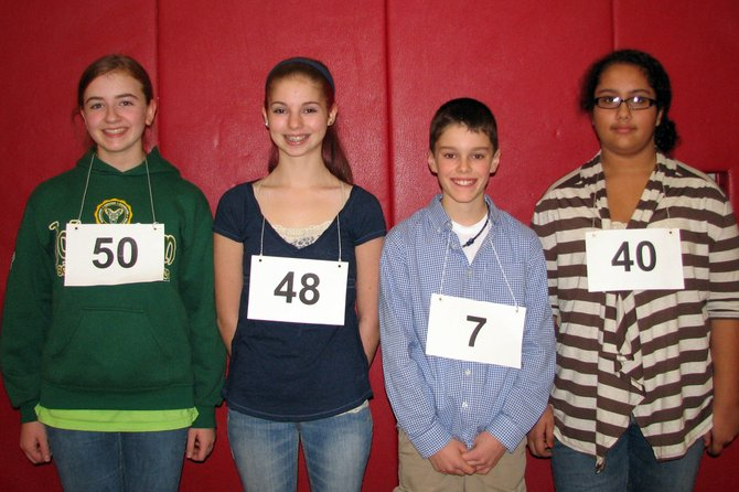 The top four finalists in the Baldwinsville Central School District Oral Spelling Bee Championship are (from left) Colleen Magowan (tied for third place), Miranda Hart (tied for third place), Lucien Jerome (second place) and Zoe Ricks (champion).