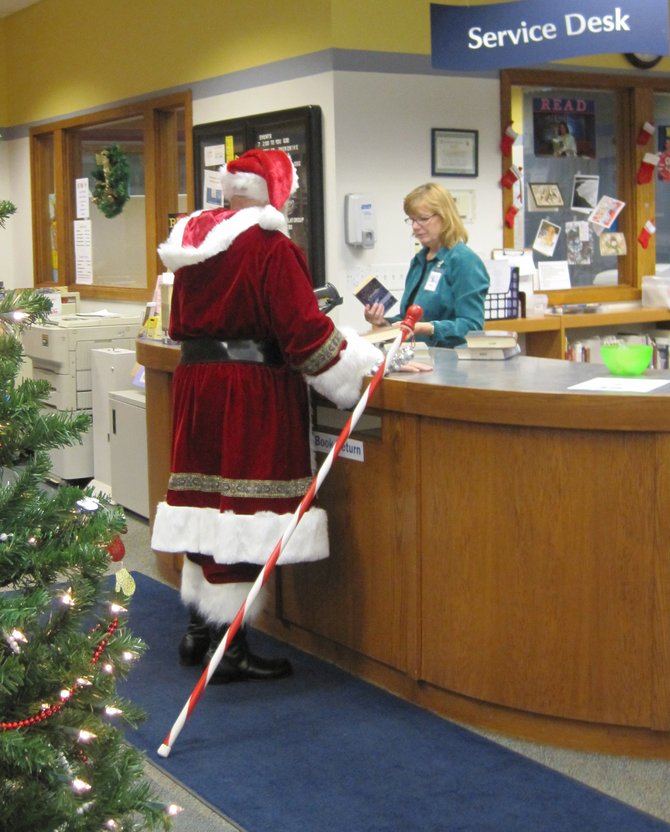 Did you know Santa has a library card? He stopped in to the Brewerton Library last week to borrow a few items, presumably in preparation for a long commute. We'll have to see if he is naughty or nice about returning them on time.