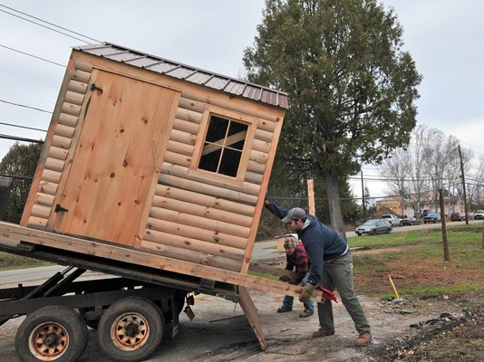 Jay Niederbuhl and Lee Daunais of Specialty Wood Products delivering shed to Old Lake Colby Road.