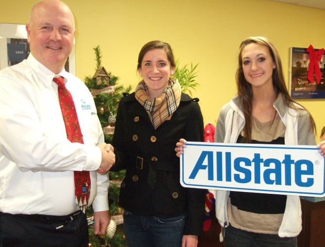 Chris Hayden, left, of Allstate Insurance will donate an iPad 2 to the 2012 Baker High School senior class for their Keep the Ball Rolling party.  Hayden is pictured with senior class' student council president Colleen Morgan, center, and student council treasurer Emma Jeffery.