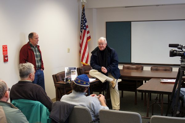 Dick Beamish (standing) and Lee Keet (sitting on table) of the Adirondack Recreation Trail Advocates talk about their plight Dec. 27.