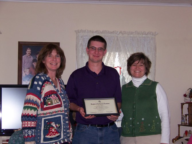 Mary Hennessey, left, presents the Betsy Baldwin Chapter of DAR's Good Citizen Essay Contest Award to Nathan James, center, while Nathan's mother, Carol James, watches.